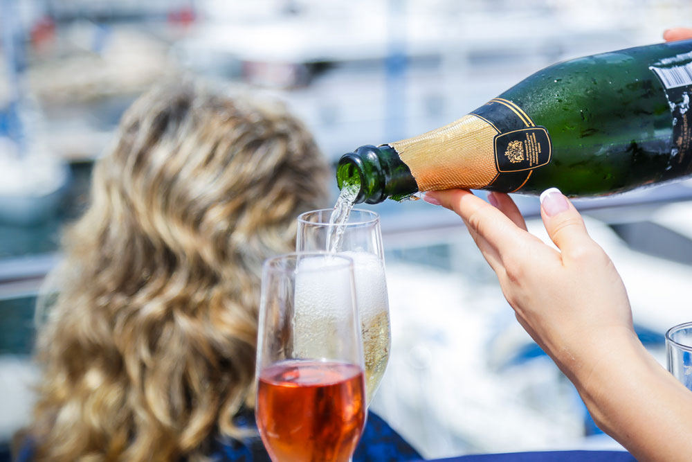 Pouring Champagne on super yacht